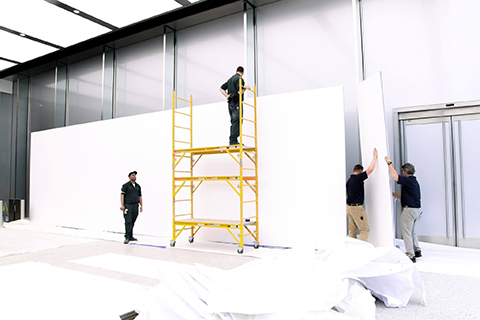 MBA employees with scaffolding during the exhibition setup with Mila-wall partitions